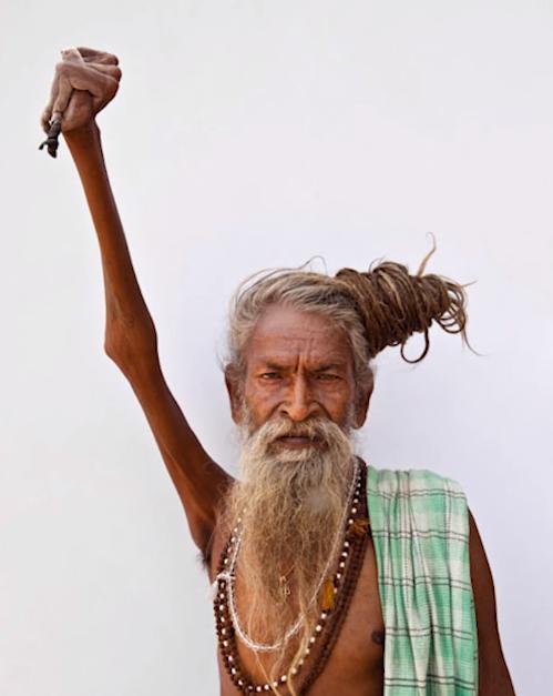 man keep his arm raised